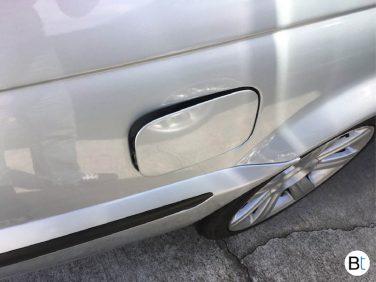 BMW fuel door emergency release tab