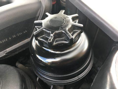 Leaking power steering reservoir cap seal BMW